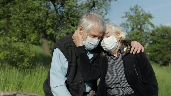 Thumbnail for Senior Couple in Medical Masks During COVID-19 Coronavirus Quarantine in Park