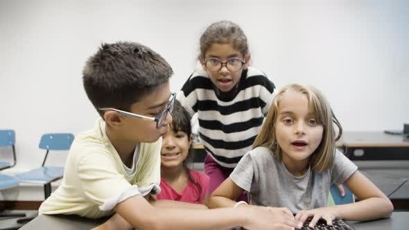 Multiethnic Children Having Fun During Computer Science Lesson