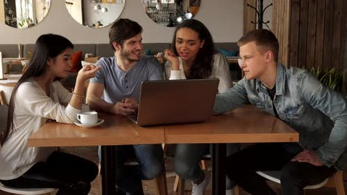 Young People Point Their Forefingers on Laptop Screen