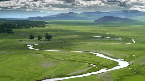 Vast Meadow and River in Central Asia Geography