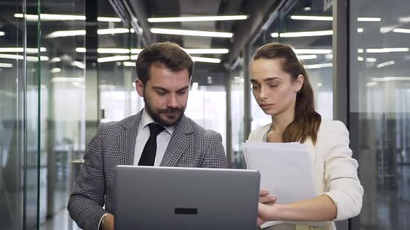 Business People which Consulting about Report Datas on Computer in the Modern Office Hall