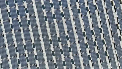 Aerial View of Floating Solar Panels Cell Platform System on the Lake