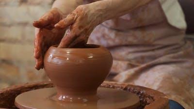 Sculptor in the Studio Makes a Clay Pot Closeup