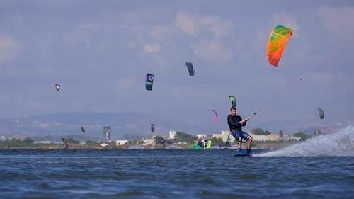 A man kiteboarding on a kite board.