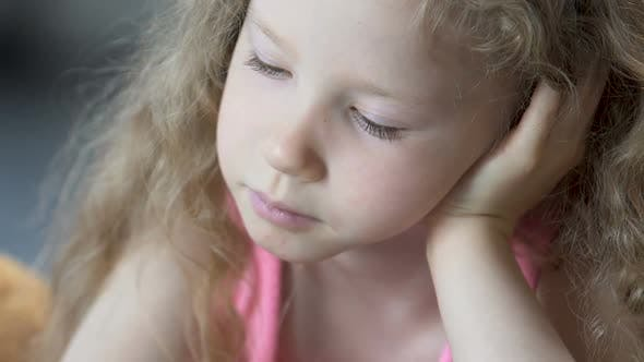 Thumbnail for Pretty Face of Smiling Blond Female Child Reading