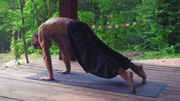 Thumbnail for Man Outdoors in Park Performs Yoga Exercises.