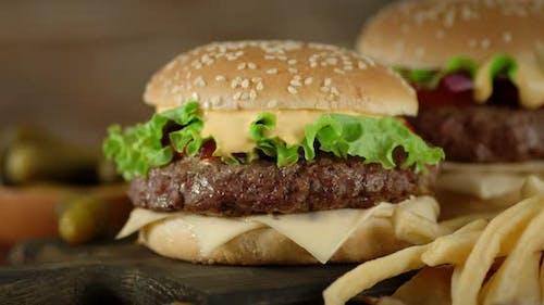 Burgers and Potato Fries Slowly Rotate.