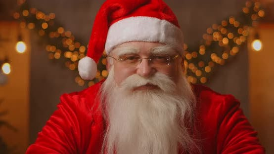 Thumbnail for Close Up of Grey-haired Santa Clause in Glasses Looking at Camera. Headshot Portrait of Funny Old