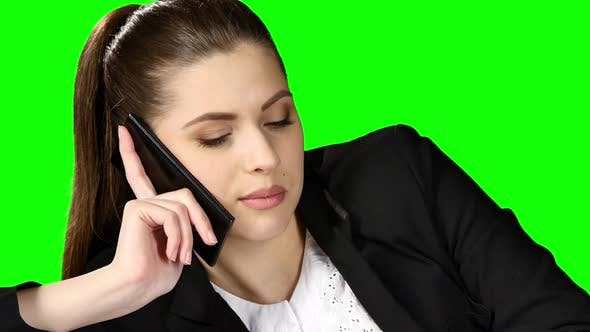 Cover Image for Charming Office Working Answering the Phone in Her Office. Green Screen