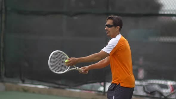 Thumbnail for Tennis player practicing serve.