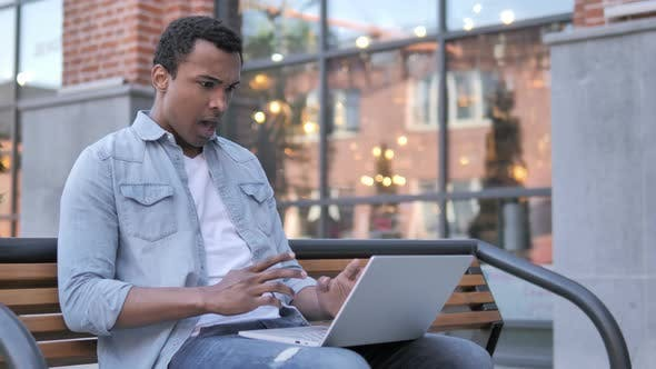Thumbnail for African Man Frustrated by Failure, Sitting on Bench