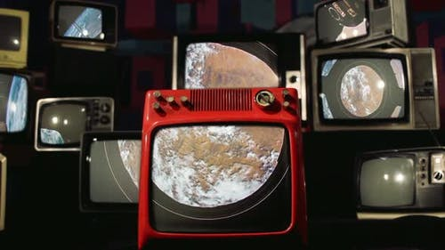 The Cupola (ISS module) and Earth as Seen on a Pile of Retro TVs.