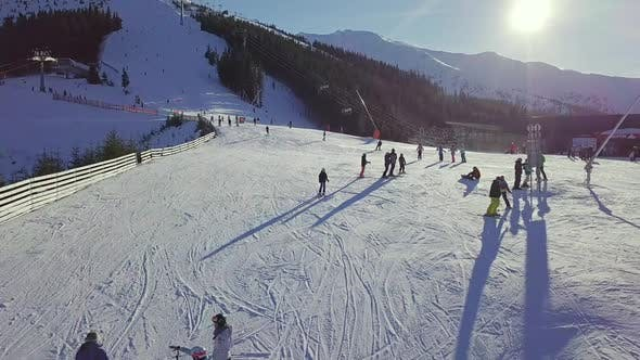 Thumbnail for Many Skiers on the Ski Slope on a Sunny Day