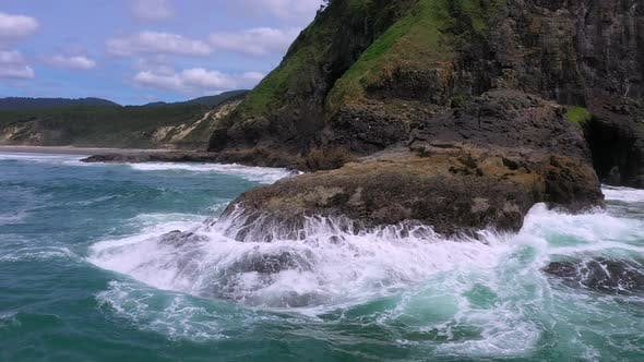 Thumbnail for Waves crashing into rocks at Heceta Head from aerial view