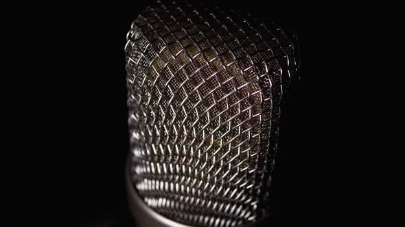 Thumbnail for Studio Condenser Microphone Rotates on Black Background