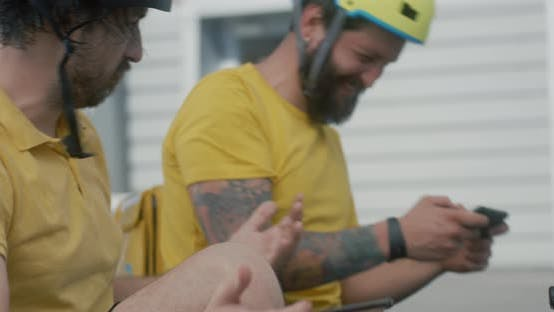 Bicycle Messengers Play Mobile Games