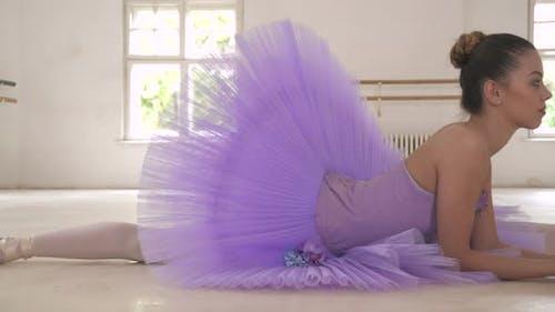 Ballerina resting in twine position