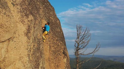 Aerial Shot of Free Solo Climbing on Rock Wall
