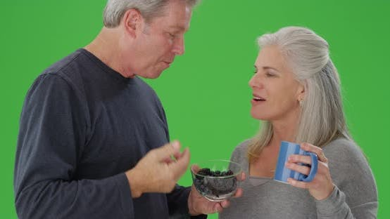 Thumbnail for Portrait of a senior white couple eating fruit