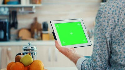 Holding Tablet Pc with Chroma Key