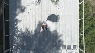 Top down aerial view of wedding couple spinning in a wedding pier 32