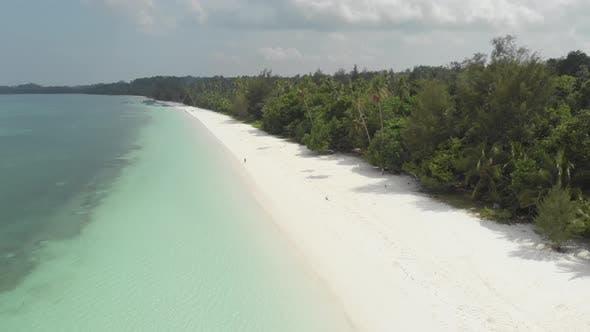 Thumbnail for Aerial: Woman on white sand beach turquoise water tropical coastline caribbean sea