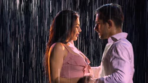 Love Story of Couple in Rain Expressed in Passionate Dance