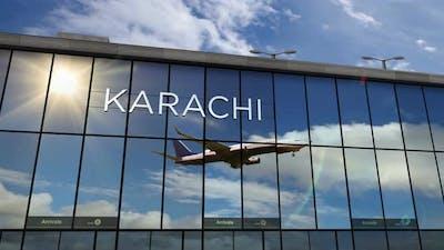 Airplane landing at Karachi Pakistan airport mirrored in terminal