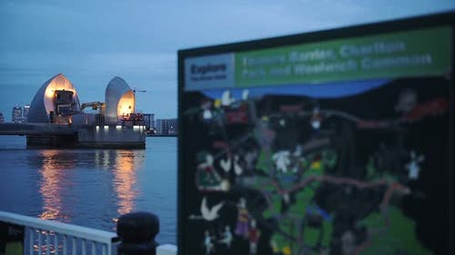 Information Map With Thames Barrier On The Background In London, England. -close up shot