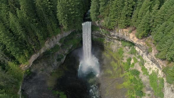 Thumbnail for Helicopter Slow Motion View Of Tall Waterfall At Massive Crater In British Columbia Canada