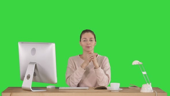 Thumbnail for Smiling millennial woman sitting at desk and talking to