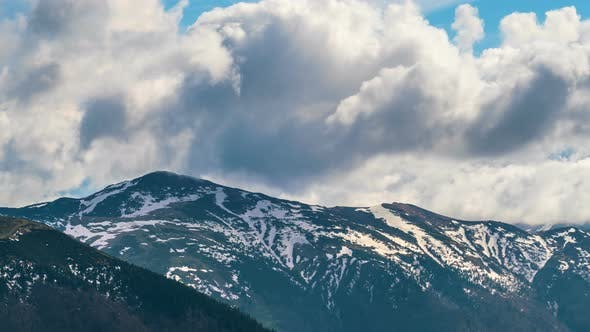 Thumbnail for Clouds Sky Moving over Alps Mountains in Early Spring Season Nature