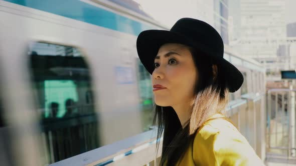 Thumbnail for Japanese woman waiting for a train in Tokyo Japan