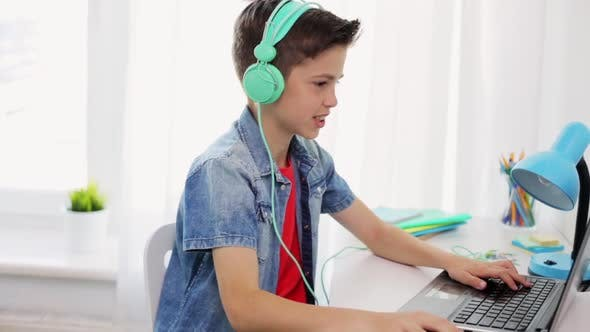 Thumbnail for Boy in Headphones Playing Video Game on Laptop