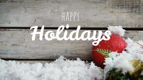 Happy holidays text and Christmas wood