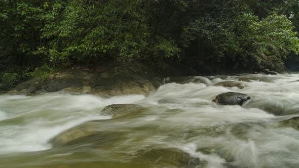 Timelapse panning shot of water fall over rock at Sungai Sedim, Kedah