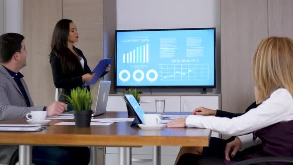 Thumbnail for Businesswoman Presenting Company Data