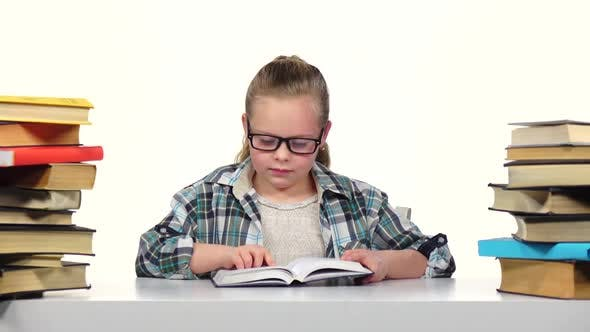 Thumbnail for Girl Chooses a Book and Starts To Read It. White Background