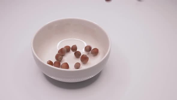 Thumbnail for Nuts fall on a plate
