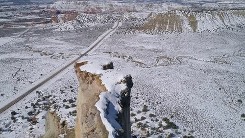 Aerial view of skinny ledge on mesa cover in snow