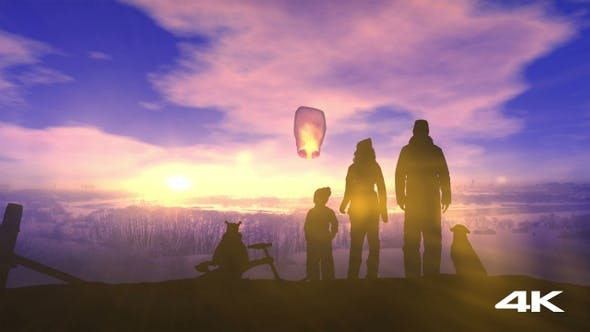 Thumbnail for A Family On A Winter Walk Launches A Chinese Lantern 4K