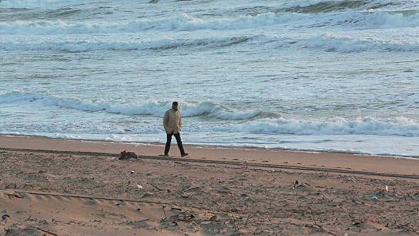 Thumbnail for Man Walking on the Beach with Storm Waves 02