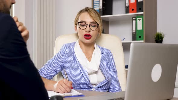 Cover Image for Human Resource Woman Taking Notes and Talking with a Canditate for the New Job
