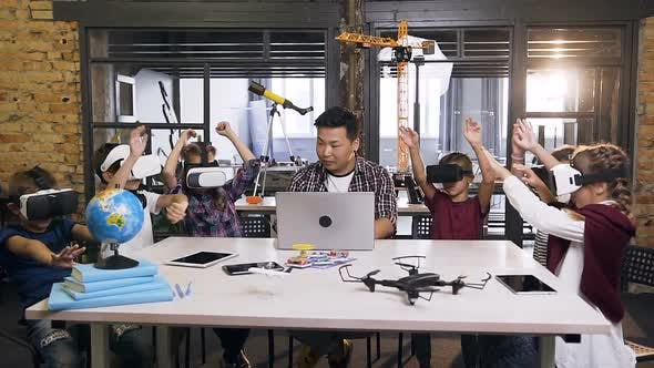 Thumbnail for Schoolteacher with Group of Caucasian Schoolchildren Having Lesson Virtual Reality