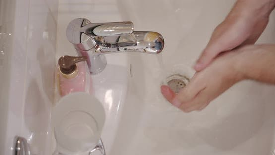 Thumbnail for Corona Virus Prevention Man Showing Hand Hygiene Washing Hands with Soap in Hot Water. Using Soap