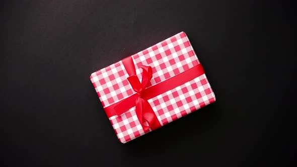 Thumbnail for Red Gift Box with Red Bow on Black Table, Top View