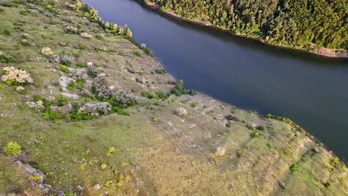 Aerial Drone View on Cliff Mountain Shores Covered with Forest