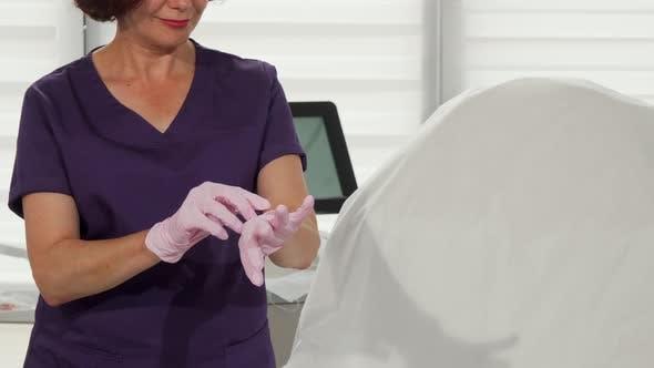 Thumbnail for Female Dermatologist Putting on Medical Gloves