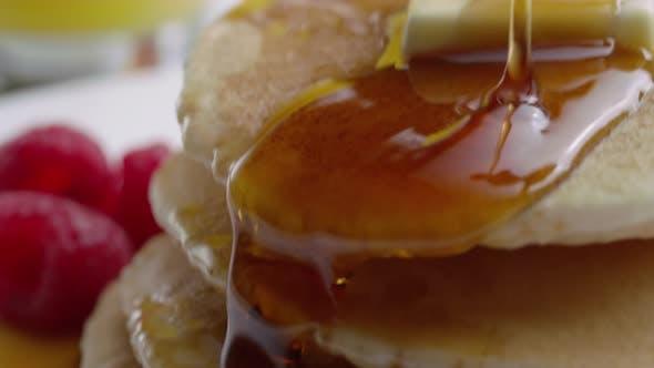 Thumbnail for Pouring syrup onto pancakes, closeup