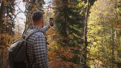 Hiker Making Autumn Selfie